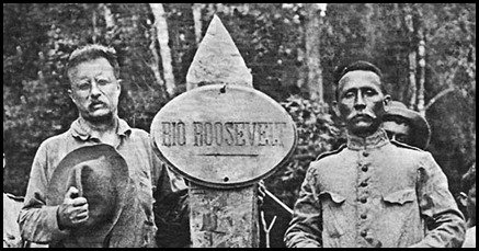 Rondon and President stand by a Rio Roosevelt marker.