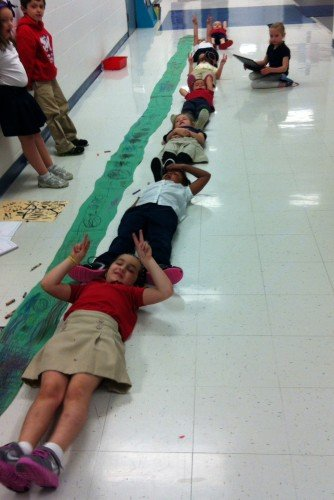 During a virtual school assembly, students learned how big an anaconda can get.